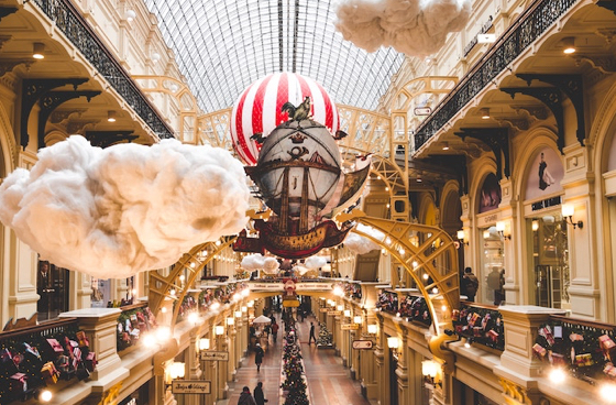 Shopping mall internal view with futuristic features such as clouds, air balloons